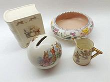 A Mixed Lot comprising: two Royal Doulton Bunnykins Moneyboxes, a Round Poo