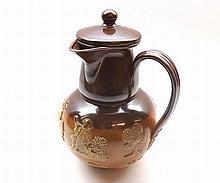 A Royal Doulton Stoneware Hot Water Jug, decorated with various hunting and