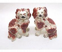 Pair of Staffordshire models of seated dogs, each with two separate front f