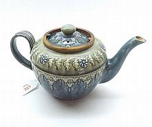A Royal Doulton Stoneware Teapot, decorated with stylised foliage on a gree