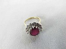 A hallmarked 18ct Gold Centre Oval Ruby (approx 10mm x 8mm) and fourteen Br