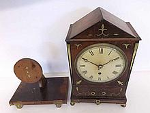 A composite Mahogany and Brass inlaid mantel Timepiece, the architectural c