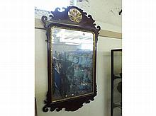 George II Mahogany and parcel gilt Wall Mirror with fret cut frame and cent