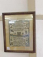 A framed antique Sampler of typical form with rows of text and various bird