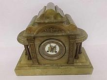 An early 20th Century Green Onyx and Gilt Metal Mounted Mantel Clock, the a
