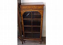 A 20th Century Queen Anne style Burr Walnut veneered bookcase cabinet with