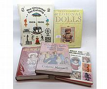 "Twelve doll reference books to include ""The Collec"
