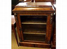 A Victorian Walnut Pier Cabinet, with raised top