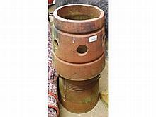 An Earthenware Circular Chimney Pot of spreading