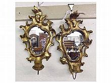 A pair of small Gilt and Gesso Mirror Back Wall S