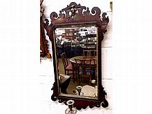 A Walnut Chippendale style Wall Mirror, the pedim