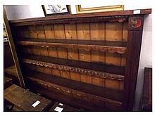 A large Stained Pine Bookcase, two uprights appli