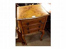 A Walnut Bedside Cabinet, moulded edge and bow fr