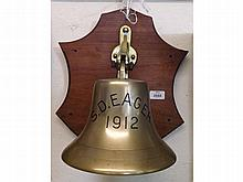 A Vintage Brass Ship's Bell, on mahogany shaped m
