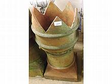 An Earthenware Chimney Pot with a hipped rim and