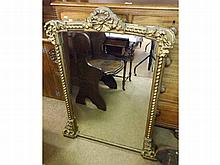 A Victorian Gilt and Gesso Overmantel Mirror, cre