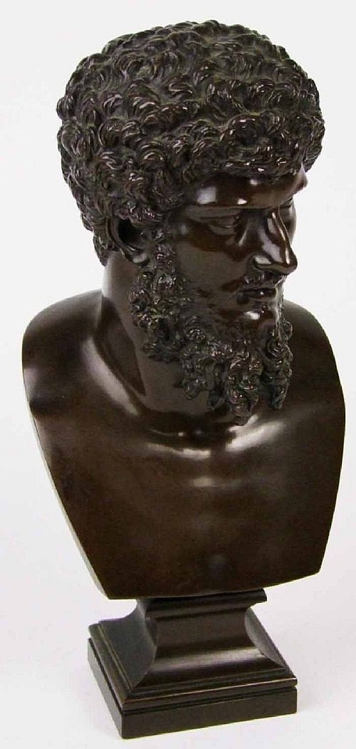 A bronze bust of Socrates, on waisted square