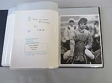 Qty of black & white photos of jockeys in album