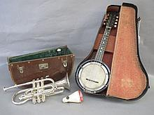 Small ebony cased banjo, with ivory pegs, by