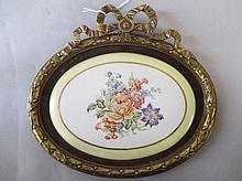 Small oval porcelain plaque painted with flowers