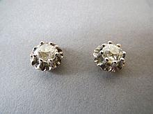 Pair of diamond stud earrings in case