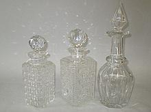 Group of three cut glass decanters & stoppers (3)
