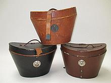 Three various hat boxes