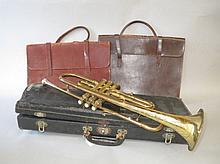American trumpet by Conn Ltd, two leather music