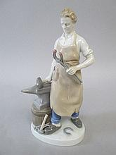 Bavarian porcelain figures of a blacksmith by his