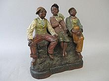 C19th American painted terracotta group with three