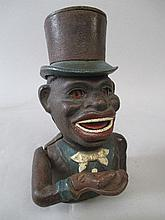 Period cast iron money box 'Jolly Nigger Bank'