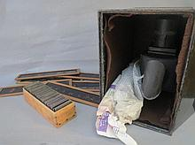 Tin cased magic lantern and a quantity of slides