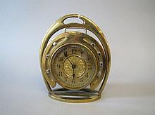 Brass clock in form of fitted horseshoe on stirrup