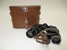 Pair binoculars in leather case