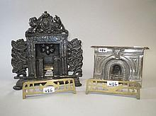 Two early cast iron dolls house, fire places & two
