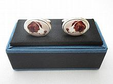 Modern silver cufflinks with hounds heads