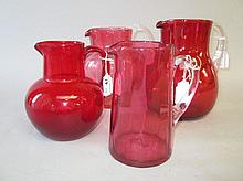 Group of four decorative Victorian cranberry glass