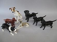 Beswick group of five porcelain models of dogs