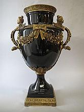 Large black glazed porcelain vase on gilt bronze