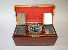 Regency figured mahogany tea caddy with two fitted