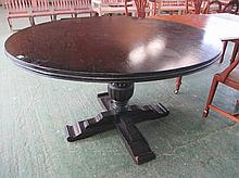 Modern circular pedestal dining table