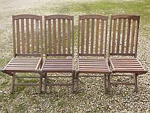 Four teak folding garden chairs