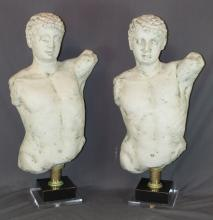 Pair of cast male torso busts on lucite stands