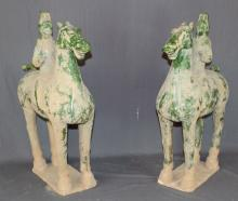 Pair of Chinese glazed terra cotta warriors on horseback