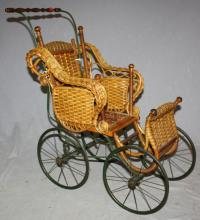 Antique wicker baby doll carriage. 26 1/2