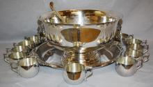 Sheffield silverplate punch bowl set with 12 cups, platter & ladel.  Bowl with lion head ring handles 15