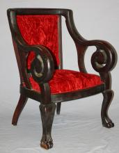 American mahogany rolled arm armchair with crushed red velevet upholstery. 37