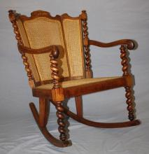 Karpen barley twist and caned seat rocking chair. American. 20th century. 32 1/8