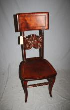 Antique carved walnut chair with North Wind mask. 39 3/4