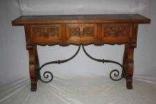 Spanish 3 drawer carved oak console with iron stretcher